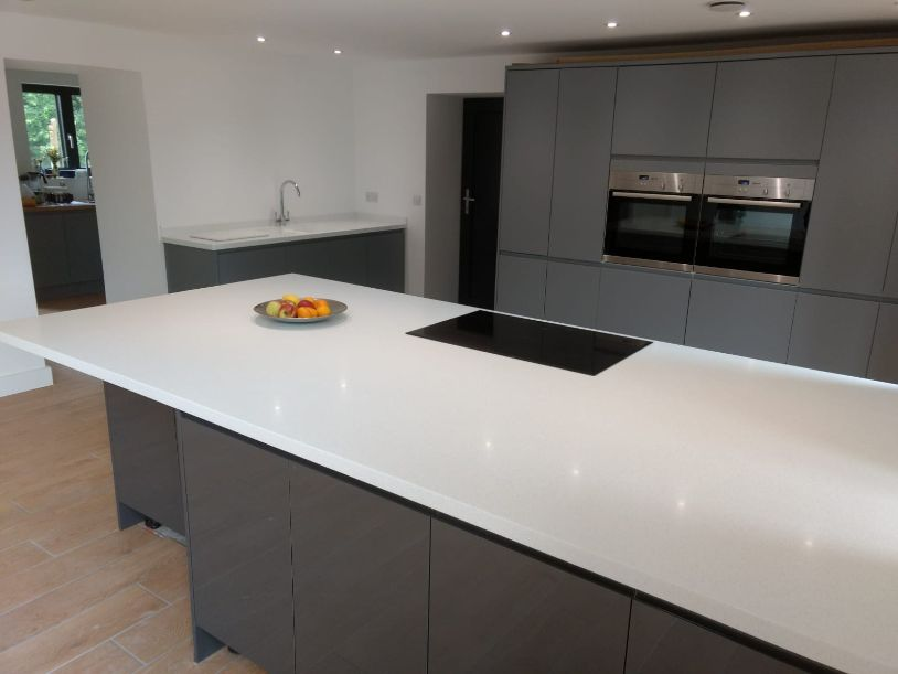 white bespoke solid surface island