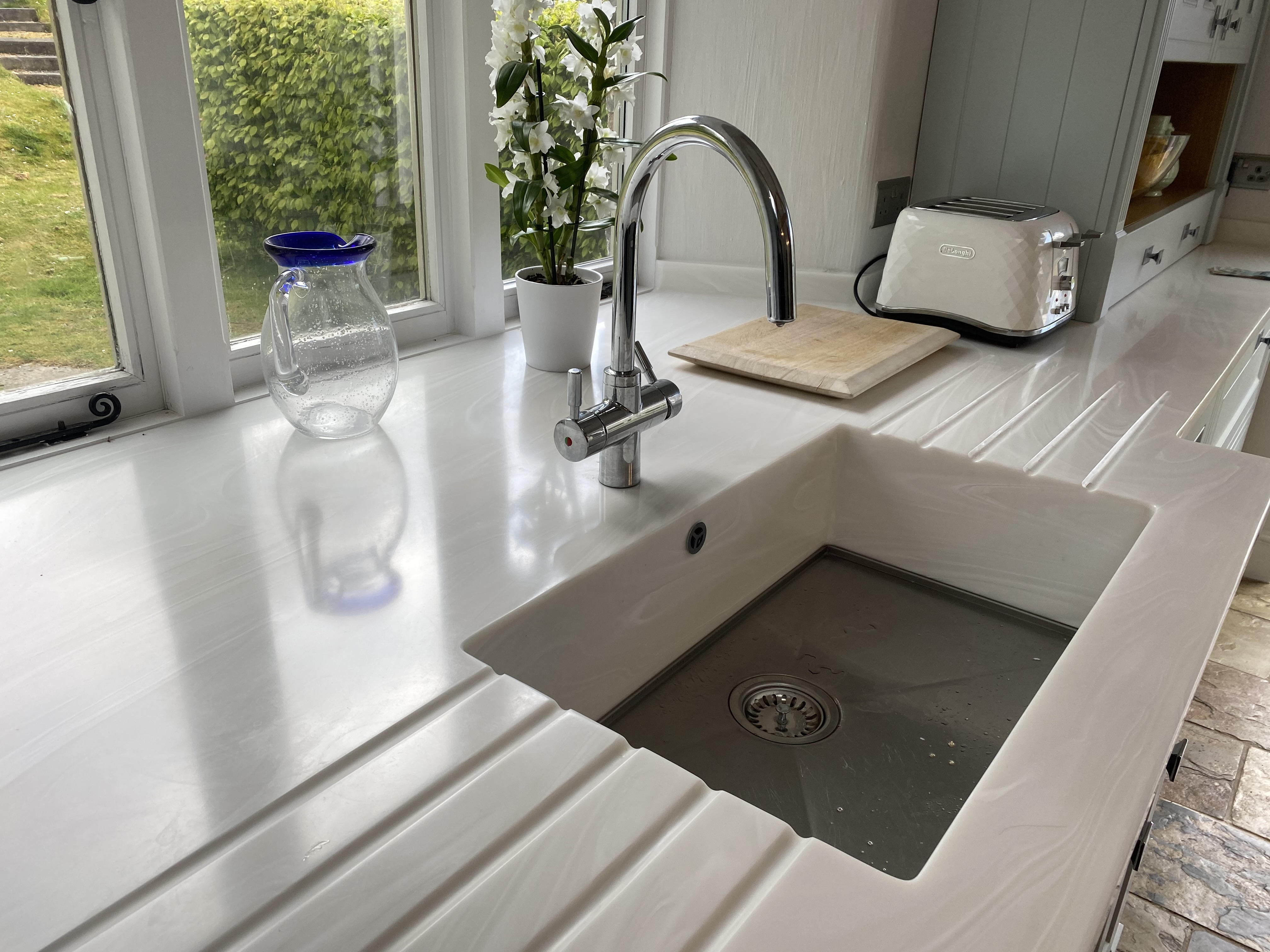 corian sinks built in drainer grooves
